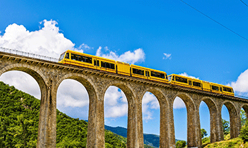 yellow-train-through-mountains-pyrenees